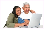 Senior indian couple on laptop
